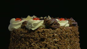 4k - Delicious chocolate cake spinning on a black background stock footage