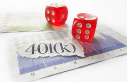 401k dice. 401K newspaper headline with red dice and stock market charts Stock Photography