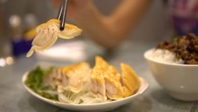 4K of Dish Smoked shark steak. Cooked in chinese restaurant. Shot in Taiwan. 4K of a Dish of a Shark meat in asia. People used chopsticks for eat Smoked shark stock footage