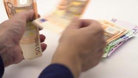 4K Dolly schot van het tellen van eurorekeningen van verschillende waarden Euro contant geldgeld stock video