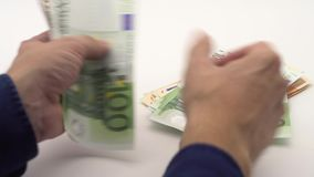 4K Dolly shot of counting euros bills of different values. Euro cash money. 4K Dolly sliding shot of hands counting euros bills of different values. Euro cash stock footage