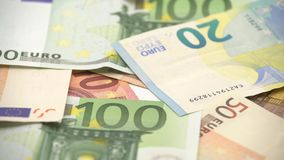 4K Dolly sliding shot euros bills of different values. Euro cash money. 4K Dolly sliding shot euros bills of different values. Euro bill of twenty, fifty, one stock video footage