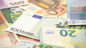4K Dolly sliding shot euros bills of different values. Euro cash money stock video