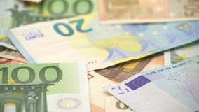 4K Dolly sliding shot euros bills of different values. Euro cash money. 4K Dolly sliding shot euros bills of different values. Euro bill of twenty, fifty, one stock footage