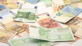 4K Dolly sliding shot of euros are falling. Banknotes of different values. Euro cash money background. Good earnings. Issuing the salary. Bank percent deposit stock video