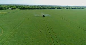 4K Drone Aerial Farm Tractor Spraying Grassland Tilt Up stock video