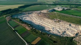 4K drone aerial footage. Fly around a mountain stone quarry. Drone aerial footage. Fly around a mountain stone quarry stock footage