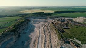 4K drone aerial footage. Fly over a mountain stone quarry. Drone aerial footage. Fly over a mountain stone quarry stock footage
