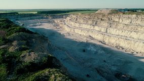 4K drone aerial footage. Fly over a mountain stone quarry. Drone aerial footage. Fly over a mountain stone quarry stock video footage