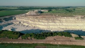 4K drone aerial footage. Fly over a mountain stone quarry. Dolly shot. Drone aerial footage. Fly over a mountain stone quarry. Dolly shot stock video footage