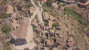 4k aerial view of Pentedattilo, church and abandoned ruins, Greek colony, Italy stock footage
