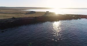 4K drone aerial over Icelandic Coast at Sunset in Northeast Iceland. Slow aerial flyover of a sheep farm by the ocean at sunset in northern Iceland, in early stock video