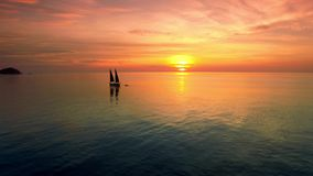 4K Drone; Sail boat at sunset, Koh Tao, Thailand. Gourgeous sunset with sailing boat stock footage