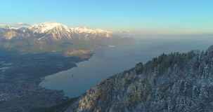 4k drone shot of lake of geneva from montain coverd with snow. 4k drone shot villeneuve lac leman hiver stock footage