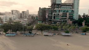 4k Drone sideways Aerial shot of Pattaya Beach and waterfront. Early morning Sunrise cityscape and skyline showing beach stock footage
