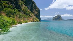 4k drone view of paradise beach and steep cliffs of Lagen island. El Nido, Palawan, Philippines. Paradise exotic unique. Nature at Marine National Park stock video footage