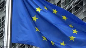 4K. European Union flag waving in front of Berlaymont Building, Brussels stock footage