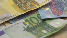 4K Euros falling. Banknotes of different values. Euro cash money background. 4K Euros are falling. Banknotes of different values. Euro cash money background stock video footage