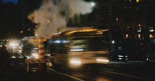 4K Evening to nighttime New York street timelapse. Steam vapor pipe. Busy crowded intersection. Vehicles and people. stock video footage