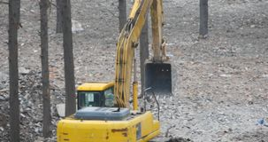 4k excavator working & dumper truck on construction site,china. 4k excavator working & dumper truck on construction site,china.  gh2_10819_4k stock video