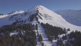 4K flat aerial view of praz de lys ski station in the French Alps in France - Log. 4K flat aerial view of praz de lys ski station in the French Alps in France stock footage
