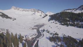 4K flat aerial view of praz de lys ski station in the French Alps in France - Log. 4K flat aerial view of praz de lys ski station in the French Alps in France stock video