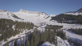 4K flat aerial view of praz de lys ski station in the French Alps in France - Log. 4K flat aerial view of praz de lys ski station in the French Alps in France stock video footage