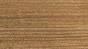 4K. Flight above freshly cultivated fields in spring, aerial top view stock footage