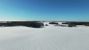 4K. Flight above snow fields in winter, aerial panoramic view. Winter land in the north.  stock footage