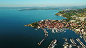 4K. Flight over old town Izola in Slovenia, aerial panoramic view with marina at sunset. Adriatic sea coast. Peninsula of Istria stock video