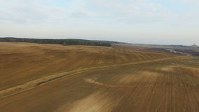 4K. Flight and takeoff above freshly cultivated fields in spring, aerial view. stock footage