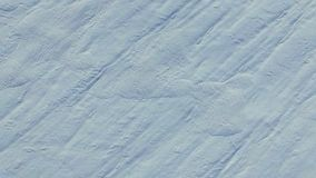 4K. Flight and takeoff above snow fields in winter, aerial top view with rotation. White snow texture stock video footage