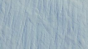 4K. Flight and takeoff above snow fields in winter, aerial top view. White snow texture stock footage