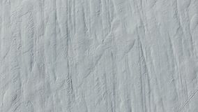 4K. Flight and takeoff above snow fields in winter, aerial top view. White snow texture stock video