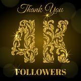 4K Followers. Thank you banner. Golden letters with sparks on a dark background. 4K Followers. Thank you banner. Decorative Font with swirls and floral elements Stock Image
