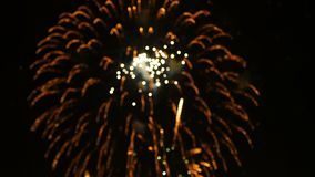 4K footage abstract blur of of close up real colorful fireworks festival light up in the sky at dark night scene for holiday. Festival and celebration stock video footage