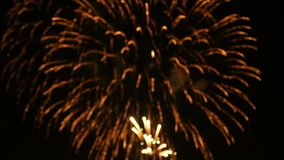 4K footage abstract blur of of close up real colorful fireworks festival light up in the sky at dark night scene for holiday. Festival and celebration stock video