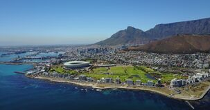 4K Footage Aerial View to the Capetown City Center with the Stadium and Green Hills, South Africa
