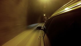 4K footage of a car going through the illuminated tunnel stock footage