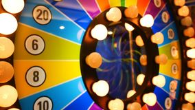 4K footage loop. retro colorful casino game cabinet flashing lights. game spinning light with bankrupt, success and fresh start. Slots. slot machine gamble stock video