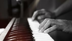 4K footage of music pianist hands playing piano at the night club with spotlight and light leak bokeh. musical instrument stock footage