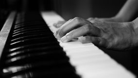 4K footage of piano music pianist hands playing monochrome black and white color. musical instrument grand piano selective focus