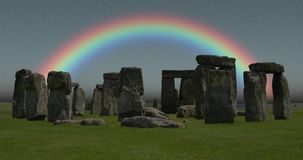 4K Footage of a rainbow over Stonehenge, shot on a typical grey rainy day in Britain stock footage