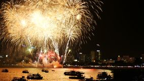4K footage of real fireworks festival in the sky for celebration at night with city view at background stock video
