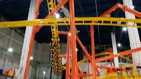 4k video of roller coaster riding in amusement park at shopping mall stock video footage