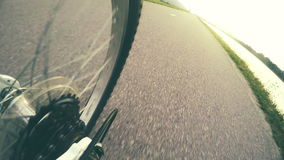 4k footage of a sport bicycle wheel rotating on the road stock video