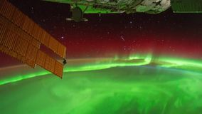 4K footage of time lapse aerospace. Beautiful and spectacular aerial view of time lapse Aurora Australis phenomenon from satellite at outer space. Earth maps royalty free illustration