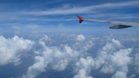 4K footage. traveling by air. view through an airplane window. wing airplane and cloud on sky.  stock footage