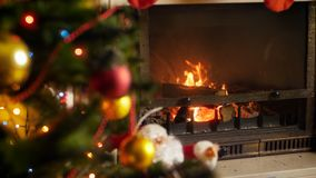 4k footage of wood logs burning in fireplace at living room decorated for celebrating Christmas or New Year. Perfect. 4k video of wood logs burning in fireplace stock video