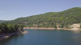 4k aerial of a fresh water lake and hydroelectric dam in Calabria, Italy stock video